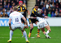 Charles Piutau of Wasps is tackled by Jack Nowell of Exeter Chiefs. European Rugby Champions Cup quarter final, between Wasps and Exeter Chiefs on April 9, 2016 at the Ricoh Arena in Coventry, England. Photo by: Patrick Khachfe / JMP