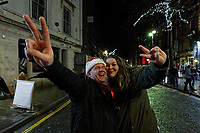 Pictured: Christmas revellers dance in Wind Street, Swansea, Wales, UK. Friday 20 December 2019<br /> Re: Black Eye Friday (also known as Black Friday, Mad Friday, Frantic Friday) the last Friday before Christmas, in Swansea, Wales, UK.