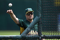 OAKLAND, CA - MAY 8:  Manager Bob Geren of the Oakland Athletics pitches batting practice before the game against the Tampa Bay Rays at the Oakland-Alameda County Coliseum on May 8, 2010 in Oakland, California. Photo by Brad Mangin
