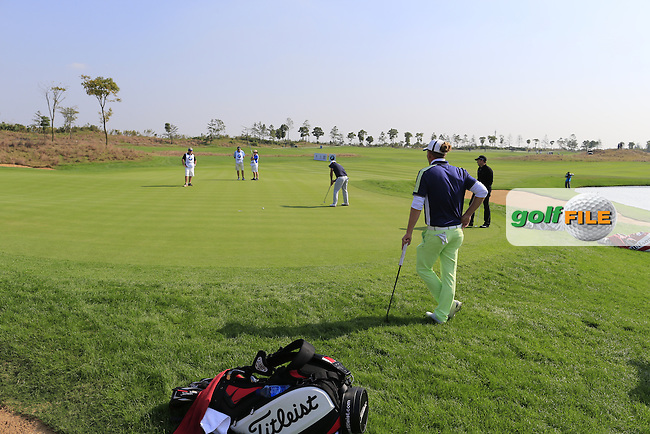 Alexander Levy (FRA) takes his putt on the 8th green as Marcel Siem (GER) watches during Sunday's Final Round of the 2014 BMW Masters held at Lake Malaren, Shanghai, China. 2nd November 2014.<br /> Picture: Eoin Clarke www.golffile.ie