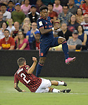 David Alaba (27, top) of Bayern Munich leaps over Davide Calabria (2) of Milan during their International Champions Cup match on July 23, 2019 at Children's Mercy Park in Kansas City, KS.<br /> Tim VIZER/AFP
