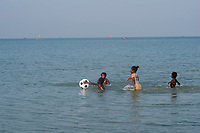 Africa, Madagascar, Ankilibe. Bakuba Hotel. Near the Tropic of Capricorn on the Mozambique channel. Children swimming in the ocean.