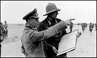 BNPS.co.uk (01202 558833)Pic:    Pen&Sword/BNPS<br /> <br /> General Rommel directs the movements of his Panzer tank force with one of his commanding officers.<br /> <br /> Fascinating rare photos of Rommel's feared Afrika Korps which terrorised the Allies in the desert have come to light in a new book.<br /> <br /> Under the direction of legendary German commander Field Marshal Erwin Rommel, who was nicknamed the Desert Fox, the corps were recognised as a superb fighting machine.<br /> <br /> They achieved their greatest triumph when they outmanoeuvred the British at the Battle of Gazala in June 1942 which led to them capturing Tobruk in Libya.<br /> <br /> But they were ultimately defeated in the iconic Battle of Alamein when they succumbed to an offensive led by Field Marshal Bernard Montgomery.
