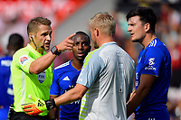 Referee Craig Pawson makes a point to Kasper Schmeichel of Leicester City as Harry Maguire of Leicester City looks on after awarding a penalty to AFC Bournemouth during AFC Bournemouth vs Leicester City, Premier League Football at the Vitality Stadium on 15th September 2018