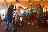Liberal, KS - Tuesday, June 17, 2014:  Mexican soccer fans celebrate Mexico's tie with Brazil after watching their first round World Cup match at Vargas restaurant in Liberal, KS.
