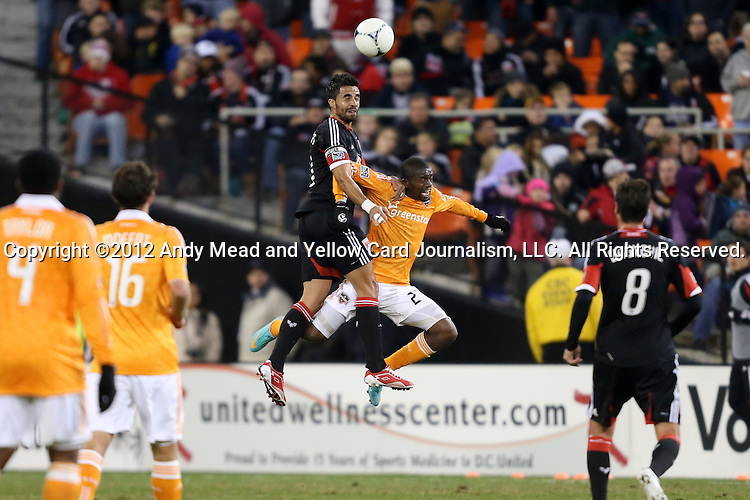 18 November 2012: DC's Marcelo Saragosa (BRA) (left) heads the ball over Houston's Boniek Garcia (HON) (27) DC United played the Houston Dynamo at RFK Stadium in Washington, DC in the second leg of their 2012 MLS Cup Playoffs Eastern Conference Final series. The game ended in a 1-1 tie, Houston won the series 4-2 on aggregate goals.