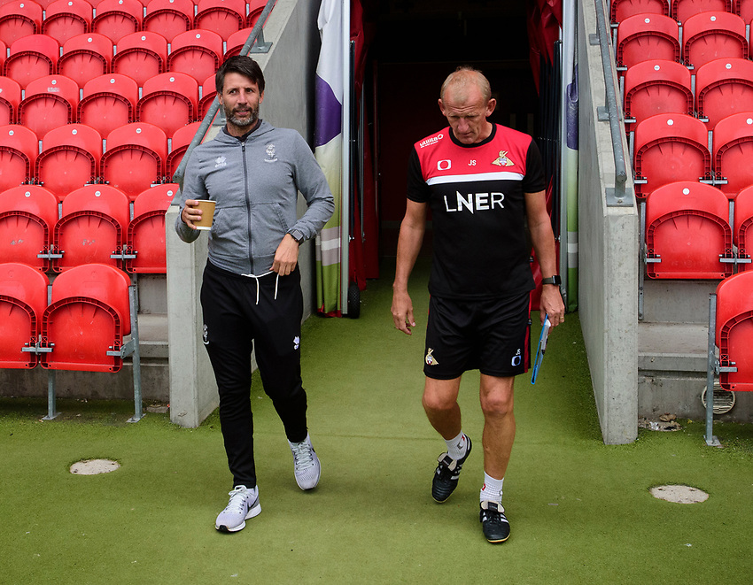 Lincoln City manager Danny Cowley, left, and Doncaster Rovers development manager John Schofield<br /> <br /> Photographer Andrew Vaughan/CameraSport<br /> <br /> EFL Leasing.com Trophy - Northern Section - Group H - Doncaster Rovers v Lincoln City - Tuesday 3rd September 2019 - Keepmoat Stadium - Doncaster<br />  <br /> World Copyright © 2018 CameraSport. All rights reserved. 43 Linden Ave. Countesthorpe. Leicester. England. LE8 5PG - Tel: +44 (0) 116 277 4147 - admin@camerasport.com - www.camerasport.com