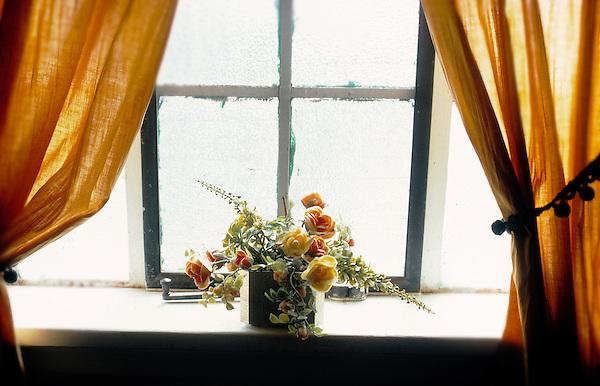Floral arrangement in window