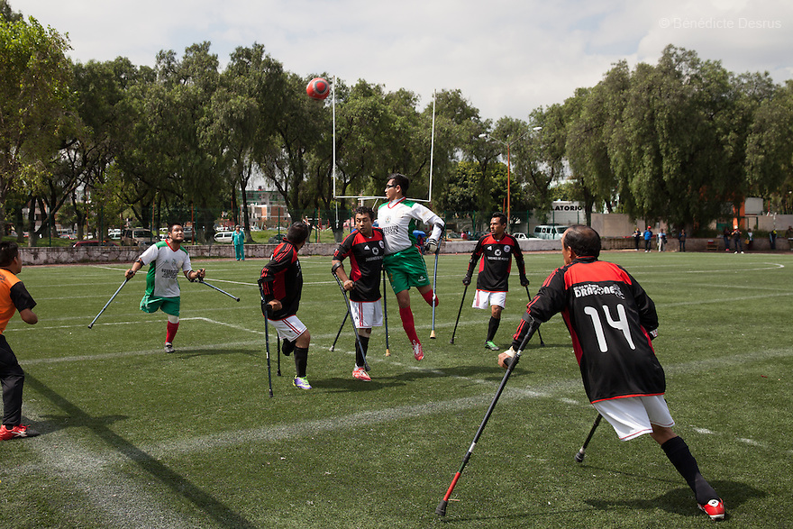 "Players from Guerreros Aztecas during a soccer game with Los Dragones (""the Dragons"") in Deportivo Tlalli II in Talnepantla, Mexico on September 27, 2014. Guerreros Aztecas (""Aztec Warriors"") is Mexico City's first amputee football team. Founded in July 2013 by five volunteers, they now have 23 players, seven of them have made the national team's shortlist to represent Mexico at this year's Amputee Soccer World Cup in Sinaloa this December. The team trains twice a week for weekend games with other teams. No prostheses are used, so field players missing a lower extremity can only play using crutches. Those missing an upper extremity play as goalkeepers. The teams play six per side with unlimited substitutions. Each half lasts 25 minutes. The causes of the amputations range from accidents to medical interventions – none of which have stopped the Guerreros Aztecas from continuing to play. The players' age, backgrounds and professions cover the full sweep of Mexican society, and they are united by the will to keep their heads held high in a country where discrimination against the disabled remains widespread. (Photo by Bénédicte Desrus)"