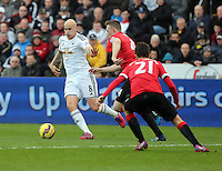 SWANSEA, WALES - FEBRUARY 21: L-R Jonjo Shelvey of Swansea tries to avoid Ander Herrera of Machester during the Barclays Premier League match between Swansea City and Manchester United at Liberty Stadium on February 21, 2015 in Swansea, Wales.