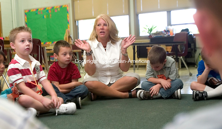 WINSTED, CT. 27 August 2008-082708SV05--Kindergarten teacher Judi Santoro has a morning meeting with her student on the first day of school at Batcheller Elementary School in Winsted Wednesday. This is the first year of all day kindergarten at the school.<br /> Steven Valenti Republican-American