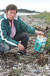 Joan Conaghy with rubbish washed up at the Haven, Baltray...Photo NEWSFILE/Jenny Matthews.(Photo credit should read Jenny Matthews/NEWSFILE)....This Picture has been sent you under the condtions enclosed by:.Newsfile Ltd..The Studio,.Millmount Abbey,.Drogheda,.Co Meath..Ireland..Tel: +353(0)41-9871240.Fax: +353(0)41-9871260.GSM: +353(0)86-2500958.email: pictures@newsfile.ie.www.newsfile.ie.FTP: 193.120.102.198.