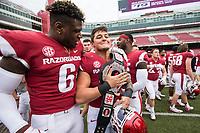 Hawgs Illustrated/BEN GOFF <br /> Gabe Richardson (6), Arkansas defensive lineman, and linebacker Grant Morgan carry the trophy belt Saturday, April 6, 2019, after the Arkansas Red-White game at Reynolds Razorback Stadium.