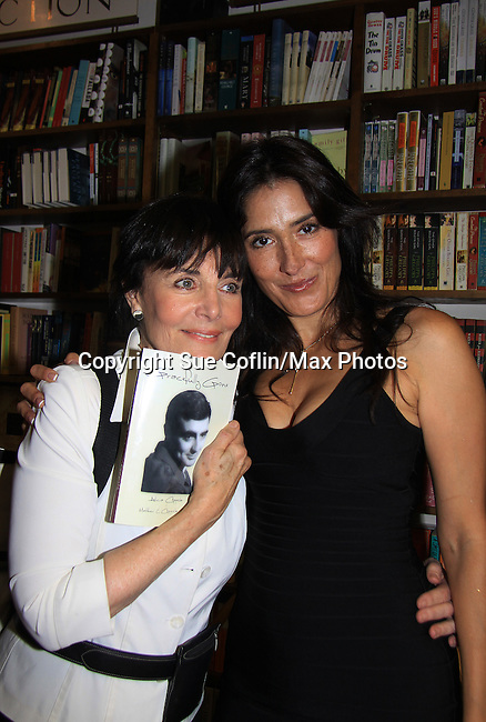 "Another World's Linda Dano (OLTL) poses with castmate Alicia Coppola (played ""Felicia's"" daughter ""Lorna"") as Alicia speaks and signs her book ""Gracefully Gone"" - a fusion of two journals: her father Matthew L. Coppola Sr. and hers - on August 23, 2013 at Book Revue, Huntington, New York. (Photo by Sue Coflin/Max Photos)"