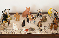 Switzerland. Canton Ticino. Sala. Table decoration in the living room of Elsy (Elsa) Hofer Ferrari Ramuz, 86 years old. Wooden and plastic cats' figurines. Elsy Hofer Ferrari Ramuz is the niece of Charles-Ferdinand Ramuz (September 24, 1878 – May 23, 1947) who was a French-speaking Swiss writer. 14.11.2017 © 2017 Didier Ruef