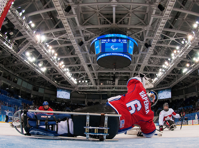 Sochi, RUSSIA - Mar 11 2014 -  Ben Delaney has his shot stopped by the Czech goalie Michal Vapenka as Canada takes on Czech Republic in Sledge Hockey at the 2014 Paralympic Winter Games in Sochi, Russia.  (Photo: Matthew Murnaghan/Canadian Paralympic Committee)
