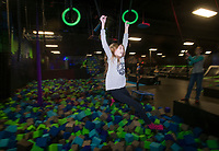 NWA Democrat-Gazette/BEN GOFF @NWABENGOFF<br /> Aubrey Tittle, 11, of Bentonville swings on an obstacle Thursday, Jan. 4, 2018, at High Rise Extreme Air Sports in Rogers.