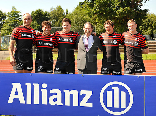 24.7.2012. Barnet, England. Clement B. Booth, Member of the Board of Management, Allianz Group and Saracens players in their new kit for the season at Saracens press conference. Saracens have announced a groundbreaking £9m sponsorship deal with Allianz that will see the insurance giant take naming rights for the rugby club's new home in north London which will be known as Allianz Park at Barnet Copthall Stadium on 24 July 2012.