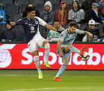 Jesus Gallardo (L) of C.F Monterrey vies for the ball with Graham Zusi of Sporting KC during their CONCACAF Champions League semifinal soccer game on April 11, 2019 at Children's Mercy Park in Kansas City, Kansas.  Photo by TIM VIZER/AFP