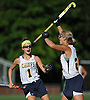 Mackenzie Conkling #1 of Massapequa, left, congratulates teammate Shannon Bernhardt #21 after she made a pass to set up a goal in the first half of a Nassau County Conference I varsity field hockey match against Baldwin at Field of Dreams Park in Massapequa on Monday, Sept. 26, 2016. Conkling recorded one goal while Bernhardt tallied three assists in Massapequa's 5-0 win.