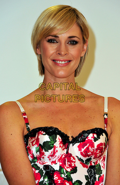 JENNI FALCONER.The face and body of Adore Moi by Ultimo and Michelle Mone, the creator of the lingerie brand launch the Bin Your Bra campaign at Debenhams, London, England..October 6th, 2009.headshot portrait white black pink lace floral print basque corset.CAP/CJ.©Chris Joseph/Capital Pictures.