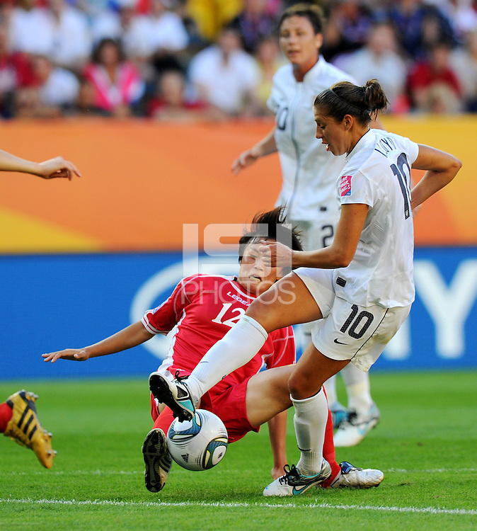 Carli Lloyd (r) of Team USA and Jon Myong Hwa of North Korea during the FIFA Women's World Cup at the FIFA Stadium in Dresden, Germany on June 28th, 2011.