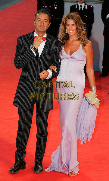 """GIULIO BASE & TIZIANA ROCCA.Arrivals - """"The Queen"""" Screening,.63rd International Venice Film Festival,.Venice, Italy, 2nd September 2006..full length.Ref: CAP/GPA/OME.www.capitalpictures.com.sales@capitalpictures.com.©GPA/Omega/Capital Pictures."""