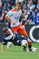 MELBOURNE, AUSTRALIA - SEPTEMBER 12, 2010: Leigh Broxham from the Victory protects the ball against Erik Paartalu from the Roar in Round 6 of the 2010 A-League between the Melbourne Victory and Brisbane Roar at AAMI Park on September 12, 2010 in Melbourne, Australia. (Photo by Sydney Low / Asterisk Images)