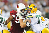 Aug. 28, 2009; Glendale, AZ, USA; Green Bay Packers guard (73) Daryn Colledge battles with Arizona Cardinals defensive end (93) Calais Campbell during a preseason game at University of Phoenix Stadium. Mandatory Credit: Mark J. Rebilas-