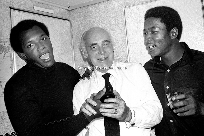 """A's owner Charlie Finley flanked by pitchers Vida Blue, and John """"Blue Moon"""" Odom...on the A's charter plane returning from Cincinnati to Oakland after the A's beat the Reds in the 1972 World Series. (Photo/Ron Riesterer)"""