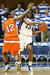 21 December 2007: Duke's Karima Christmas (13) is defended by Bucknell's Amanda Brown (12). The Duke University Blue Devils defeated the Bucknell University Bisons 92-49 at Cameron Indoor Stadium in Durham, North Carolina in an NCAA Division I Women's College Basketball game.