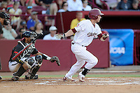 Second baseman DC Arendas (7) of the South Carolina Gamecocks bats in an NCAA Division I Baseball Regional Tournament game against the Maryland Terrapins on Sunday, June 1, 2014, at Carolina Stadium in Columbia, South Carolina. The Maryland catcher is Kevin Martir. Maryland won, 10-1, to win the tournament. (Tom Priddy/Four Seam Images)