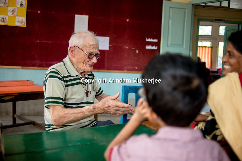 Father Laborde interacts with a teacher who looks after the mentally challanged students at Asaha Neer on Andul Road in Howrah.West Bengal, India, Arindam Mukherjee/Agency Genesis