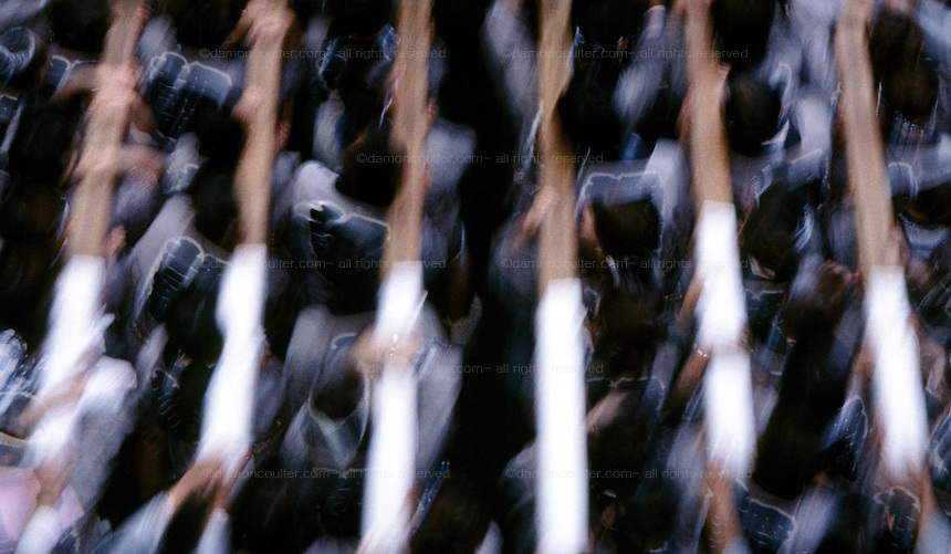 Abstract image of people carrying a mikoshi or portable shrine at a matsuri (festival) in Shinjuku, Tokyo, Japan. September 2004