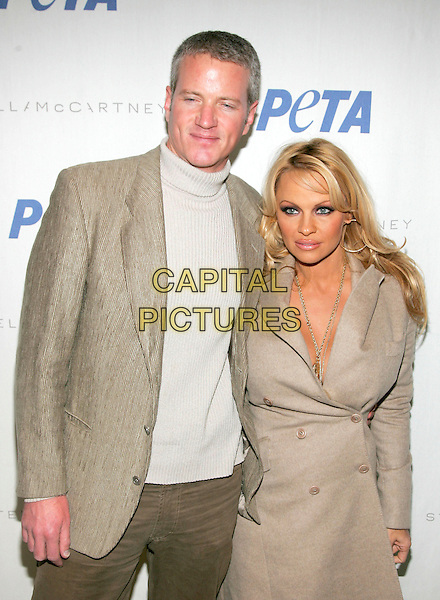 DAN MATTHEWS & PAMELA ANDERSON.At the an event hosted by PETA (People for the Ethical Treatment of Animals) to honor people who have made outstanding contributions in promoting PETA campaigns that take a stand against cruelty to animals,.New York, NY, USA, 03 February 2006. .half length Lee.Ref: ADM/JL.www.capitalpictures.com.sales@capitalpictures.com.© Capital Pictures.