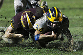 Joshua Cantu (34), Clarkston, dives forward for extra yardage with defender Gabe Ellis, Davison, on his back during Division 1 district final football action at Davison High School Saturday, Nov. 4, 2017. Clarkston defeated Davison in convincing style 28-0. (For The Oakland Press / LARRY McKEE)