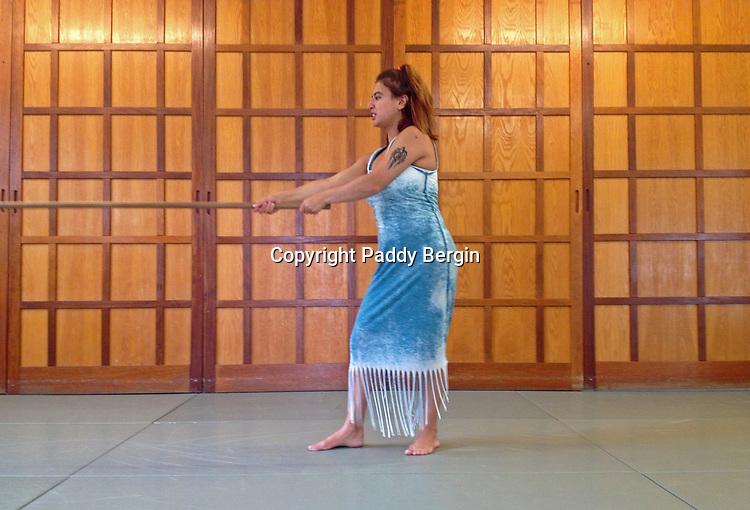 Yasmin models the jo no kamai position in the San Ju Ich Jo Kata from Iwama Style Aikido at The London Aikido Club in Stoke Newington, London N16.<br /> <br /> Stock Photo by Paddy Bergin
