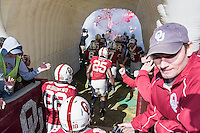 Oklahoma quarterback Baker Mayfield (6) greets members of team in the tunnel before NCAA football game kickoff, Saturday, November 08, 2014 in Norman, Tex. (Mo Khursheed/TFV Media via AP Images)