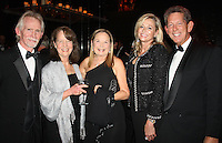 NWA Democrat-Gazette/CARIN SCHOPPMEYER Joe and Jean Ann Fennel (from left), Marti Sudduth and Sheri Rothwell and Woody Bassett enjoy the Walton Arts Center's grand re-opening gala Nov. 17 at the newly renovated arts center in Fayetteville.