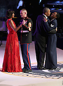 United States President Barack Obama and first lady Michelle Obama dance with members of the U.S. armed forces during the Commander-In-Chief Ball at the Walter Washington Convention Center January 21, 2013 in Washington, DC. President Obama started his second term by taking the Oath of Office earlier in the day during a ceremony on the West Front of the U.S. Capitol. .Credit: Chip Somodevilla / Pool via CNP
