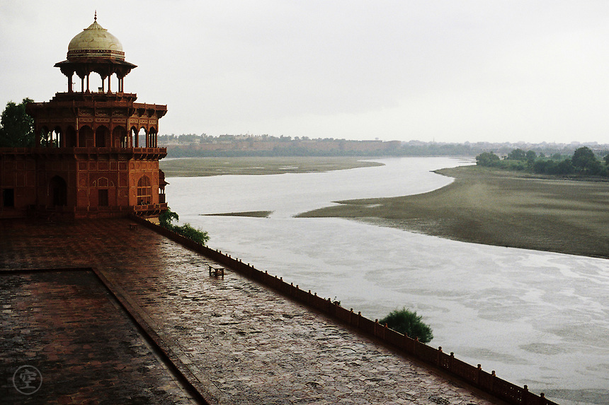 The ramparts of the Taj Mahal above the river Jamuna during a heavy rainfall, India.