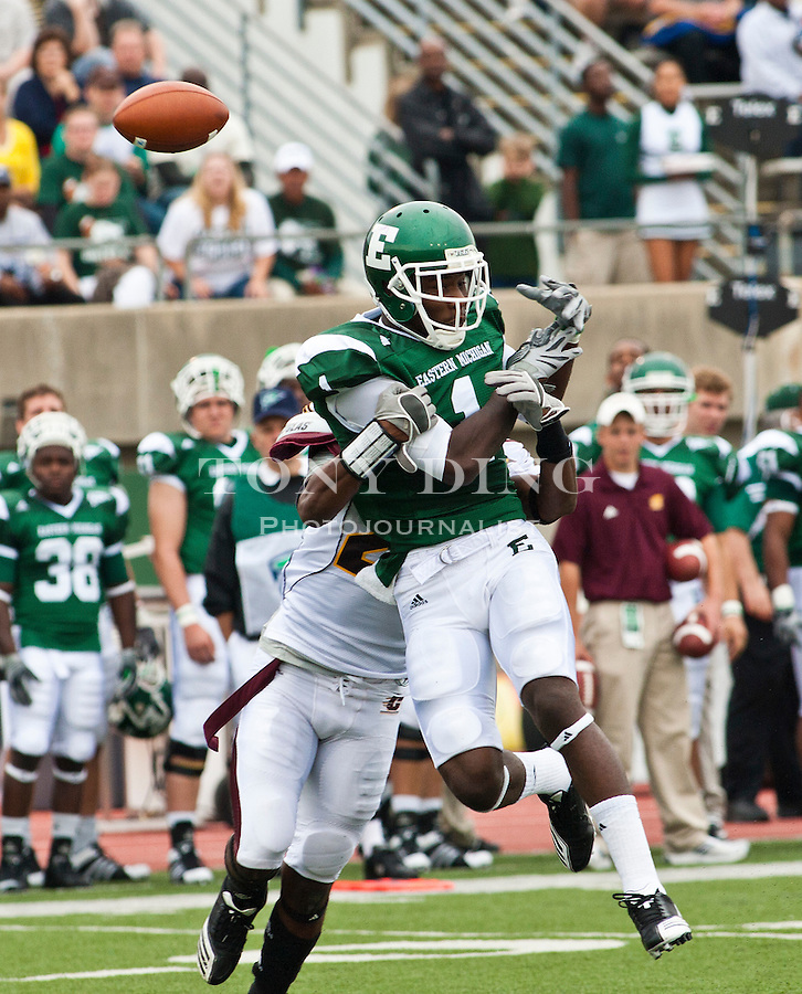 Central Michigan cornerback LaVarus Williams breaks up a reception by Eastern Michigan wide receiver Kinsman Thomas, front, in the first quarter of an NCAA college football game, Saturday, Sept. 18, 2010, in Ypsilanti, Mich. (AP Photo/Tony Ding)