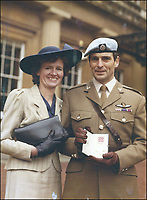 BNPS.co.uk (01202 558833)<br /> Pic: DNW/BNPS<br /> <br /> Maj Alan Wiles at the Palace with his wife to receive his MBE in 1987.<br /> <br /> The incredible tale of Argentina's little known first invasion of the Falklands islands revealed as Royal Marine heroes medals are sold.<br /> <br /> The medal group of a Royal Marine who was taken hostage by Argentinian terrorists when they tried to claim the Falklands 16 years before the war are being sold.<br /> <br /> Major Alan Wiles was serving as a PT instructor for the Dad's Army-like Falkland Islands Defence Force when a hijacked Argentine airliner landed on the racecourse at Stanley. <br /> <br /> Thinking the Douglas DC-4 plane was in distress the British army officer, who was trout fishing at the time, rushed to the scene only to be met by 18 armed hijackers.<br /> <br /> The El Condor group, that had forced the pilot at gunpoint to divert 400 miles to the Falklands, raised the Argentine flag and demanded Britain recognised the islands as their country's.<br /> <br /> They surrendered less than 24 hours later.<br /> <br /> Now Maj Wiles medals are coming up for auction in London.