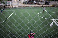 "June 16, 2018: Young kids play at a football yard in the ""Sinai"", a violence-plagued neighbourhood in the outskirts of Acapulco, Guerrero."