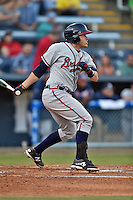 Rome Braves catcher Victor Caratini #15 swings at a pitch during a game against the Asheville Tourists at McCormick Field on May 1, 2014 in Asheville, North Carolina. The Tourists defeated the Braves 8-7. (Tony Farlow/Four Seam Images)