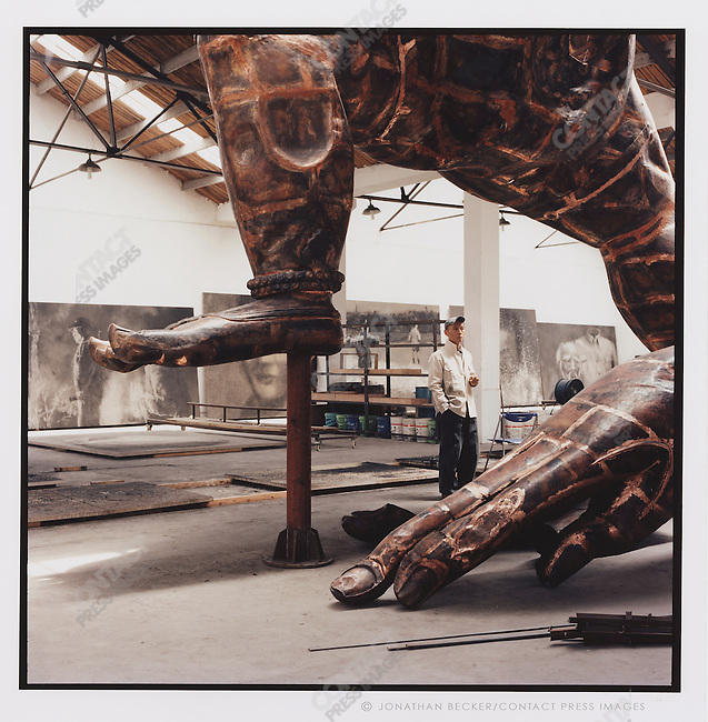"Zhang Huan, in his studio with his sculpture ""Two Legged Buddha"", Beijing, China, 2007"