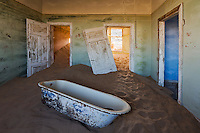 A room with a bath in the ghost town of Kolmanskop in Namibia.