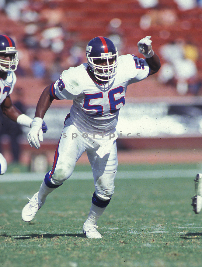 New York Giants Lawrence Taylor (56) in action during a game against the Los Angeles Raiders on October 4, 1992 at Los Angeles Memorial Coliseum in Los Angeles , California. The Raiders beat the Giants 13-10. Lawrence Taylor was inducted to the Pro Football Hall of Fame in 1999.