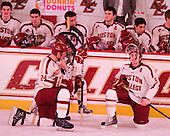 The lights over the ice went out, but the advertising lights, as well as the concourse lights, remained on casting a pink glow as they showed the BC logo. The power outage was caused by a car accident. Bill Arnold (BC - 24) and Barry Almeida (BC - 9) kneel on the ice in front of the BC bench. - The Boston College Eagles defeated the visiting University of Massachusetts-Amherst Minutemen 2-1 in the opening game of their 2012 Hockey East quarterfinal matchup on Friday, March 9, 2012, at Kelley Rink at Conte Forum in Chestnut Hill, Massachusetts.