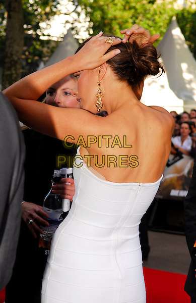 "KATE BECKINSALE .UK premiere of ""Die Hard 4.0: Live Free or Die Hard"" at the Empire Leicester Square, London, England..June 20th, 2007.white strapless dress beck behind gold earrings hand arm adjusting hair fixing gesture half length.CAP/IA.©Ian Allis/Capital Pictures"